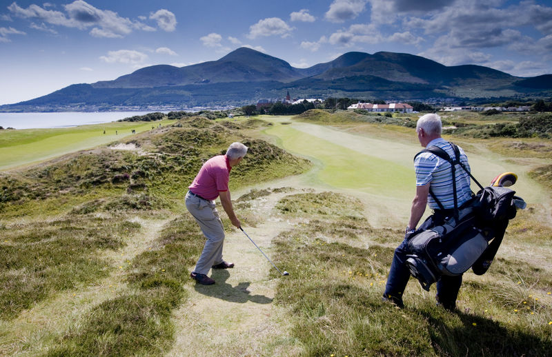 Golfers golfing on Royal County Down as part of our Platinum Package to The 148th Open
